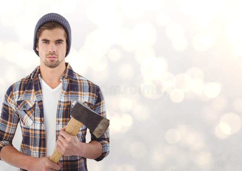 Stående av den hållande yxan för säker manlig hipster över bokeh fotografering för bildbyråer