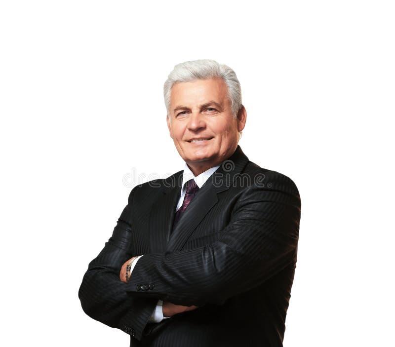 Stående av den lyckade mogna affärsmannen, på vit bakgrund royaltyfri bild