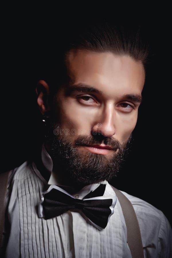 Stående av den stiliga mannen som poserar för fotograf i studio arkivbilder