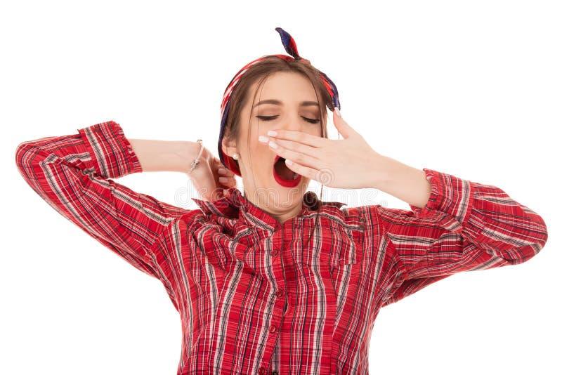 Stående av den trötta flickan som gäspar royaltyfri foto