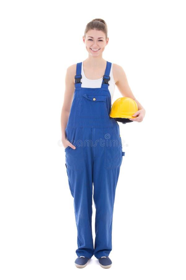 Stående av den unga attraktiva kvinnabyggmästaren i blå workweariso royaltyfri bild