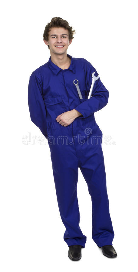Stående av den unga mekanikern With Worktools arkivfoto