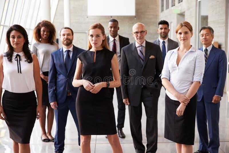 Stående av denkulturella affären Team In Office royaltyfria foton