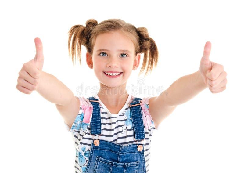Stående av det förtjusande le liten flickabarnet med två tummar u royaltyfria foton