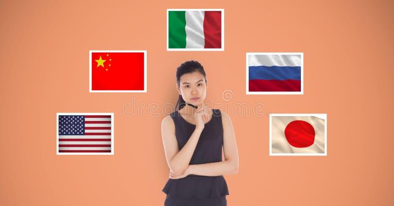 Stående av det härliga anseendet för hållande penna för kvinna vid flaggor mot orange bakgrund royaltyfri illustrationer