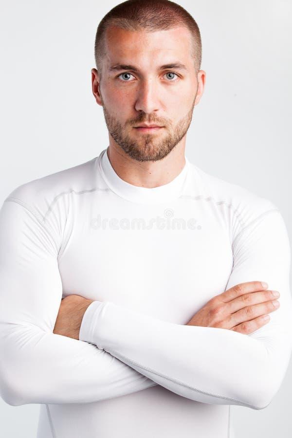 Stående av en attraktiv sportman royaltyfri fotografi