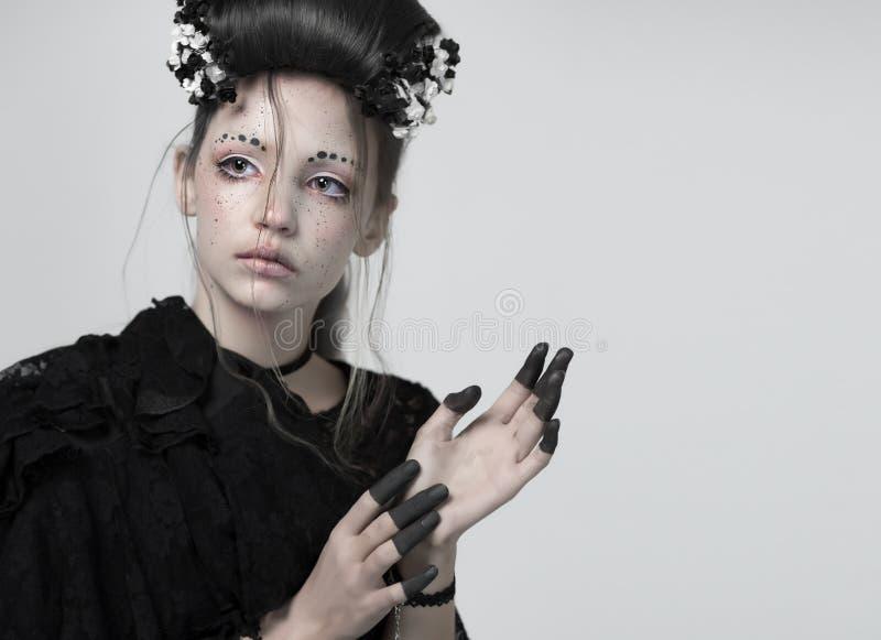 Stående av en flicka idérik makeup royaltyfri fotografi