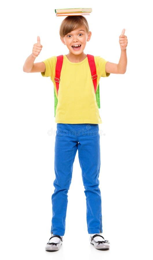 Stående av en gullig liten skolflicka med ryggsäcken royaltyfria bilder