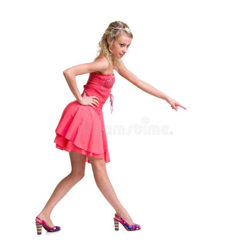 Stående av en härlig flicka i klänningen som isoleras på royaltyfria bilder