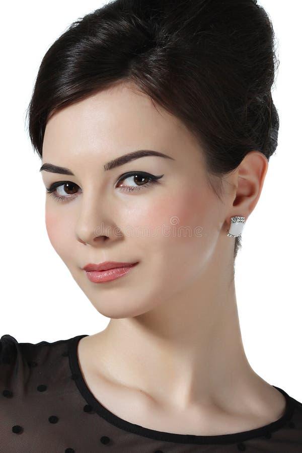 Stående av en härlig flicka med smink arkivfoton