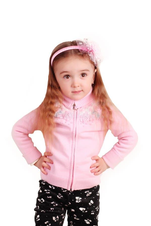 Stående av en lycklig liten flicka som isoleras över vit royaltyfria bilder