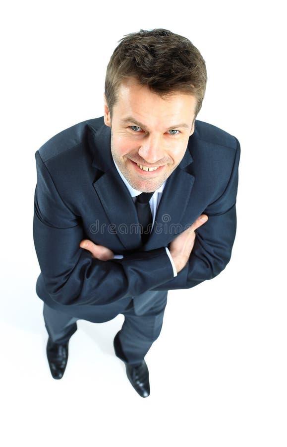 Stående av en lycklig man för mogen affär som ser säkra agains arkivfoton
