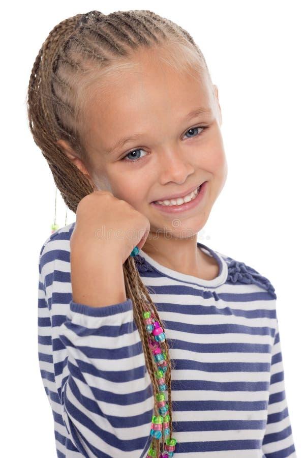 Stående av en lycklig ung flicka arkivbild