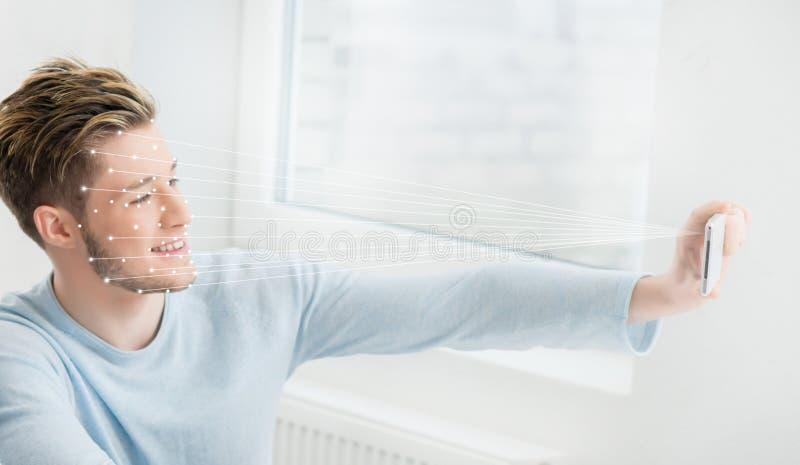 Stående av en man med ett scnanning raster på hans framsida FramsidaID, säkerhet, ansikts- erkännande, framtida teknologi royaltyfri fotografi
