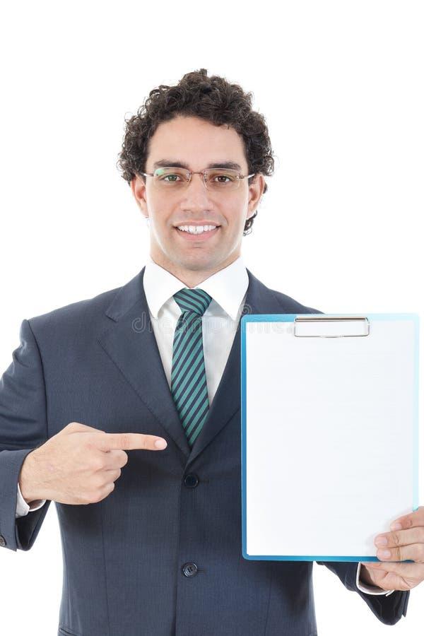 Stående av en manlig chef som rymmer ett vitt bräde arkivfoton