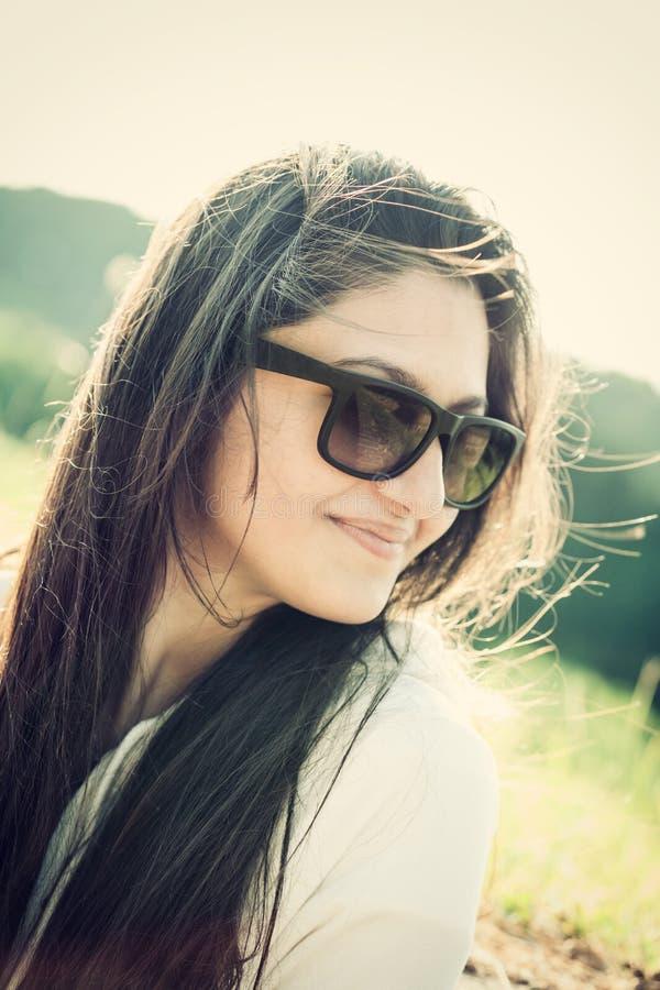 Stående av en tonåring med solglasögon royaltyfria bilder