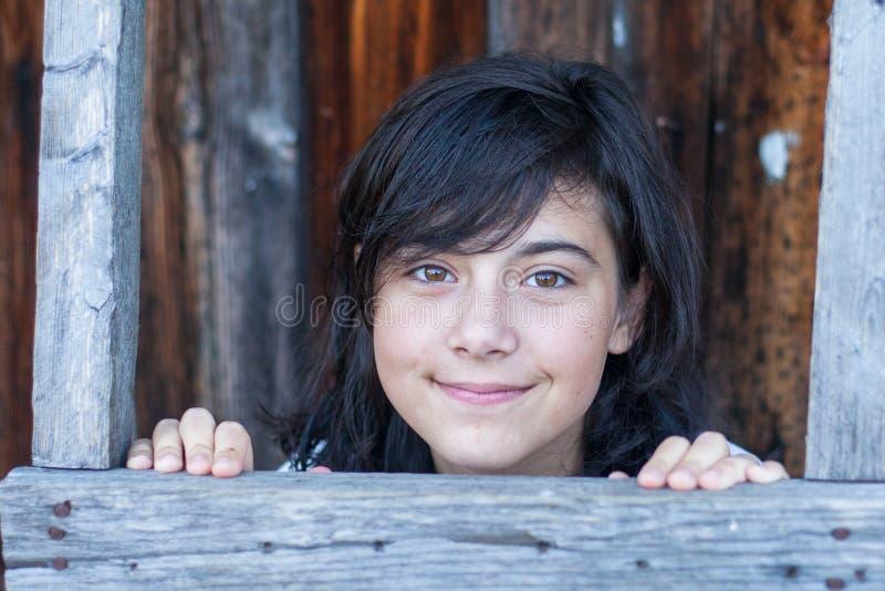 Stående av en ung flicka i byn royaltyfria foton