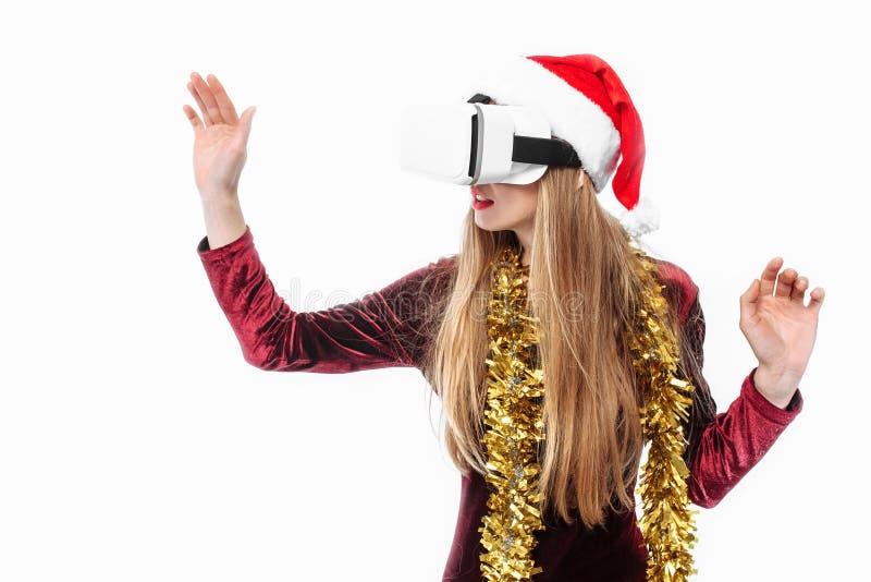 Stående av en ung flicka i en Santa Claus hatt med exponeringsglas, G 3D royaltyfri foto