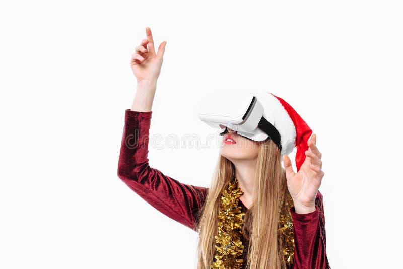 Stående av en ung flicka i en Santa Claus hatt med exponeringsglas, G 3D royaltyfria bilder
