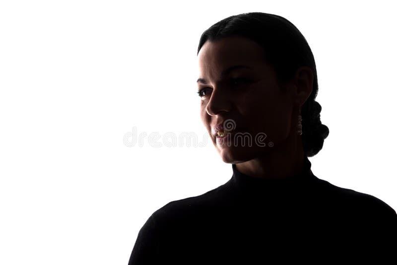 Stående av en ung kvinna, sidosikt royaltyfria foton