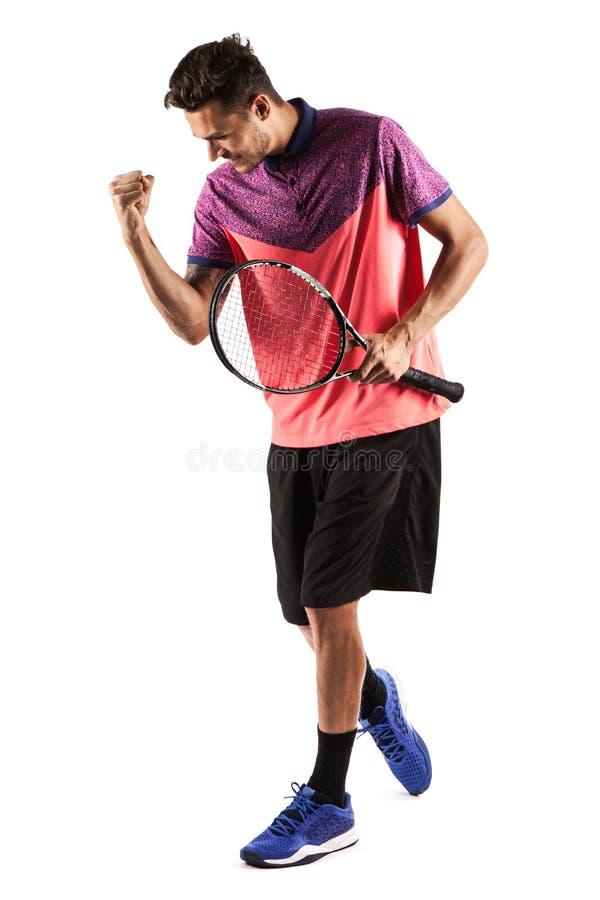 Stående av en ung manlig tennisspelare som firar hans framgång royaltyfri fotografi