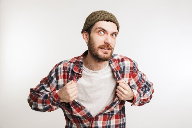 Stående av en ung skäggig man i plädskjorta arkivbilder