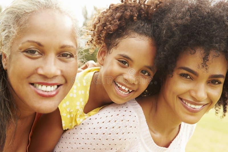 Stående av farmodern med dottern och sondottern royaltyfria bilder