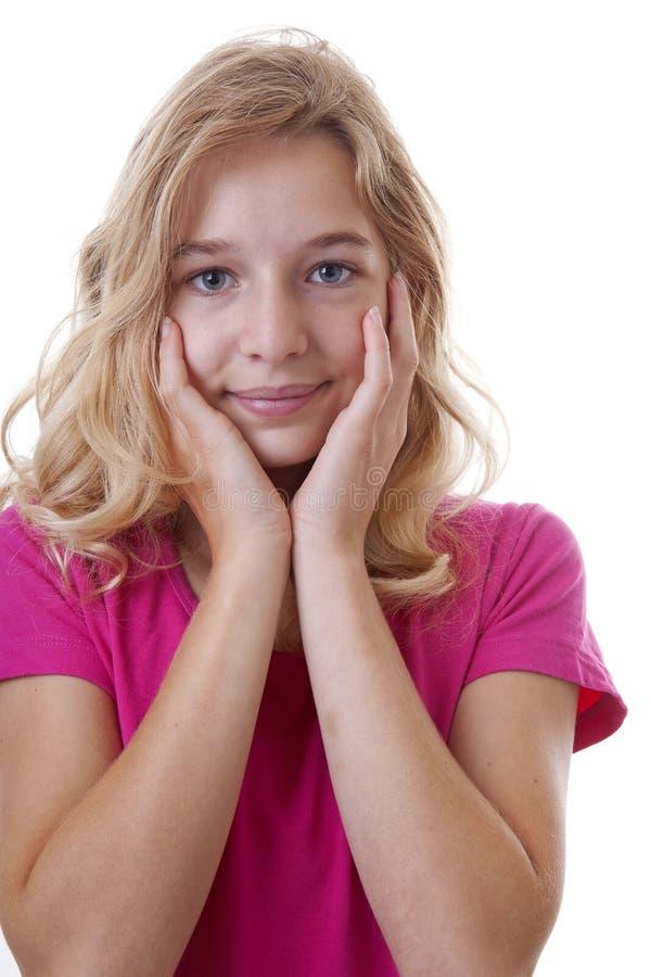 Stående av flickan som ser förvånad över vit bakgrund arkivbilder