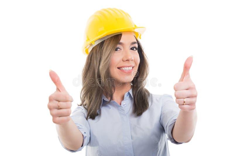 Stående av kvinnlig konstruktörvisningdubblett som gest royaltyfria foton