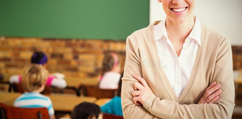 Stående av läraren på baksida av klassrumet royaltyfri bild