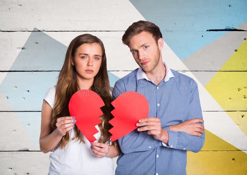 Stående av ledsna par som rymmer brutna hjärtor arkivbild