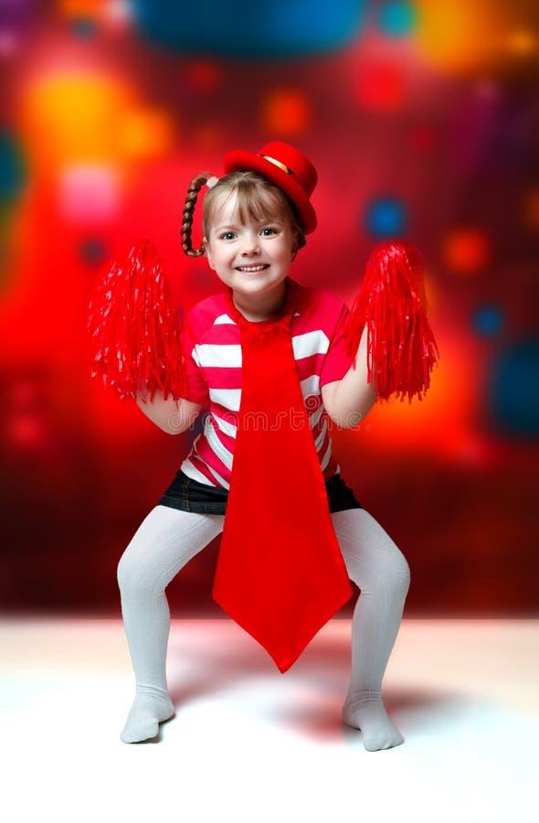Stående av lilla flickan i karnevaldräkt på abstrakt backgrou royaltyfri bild