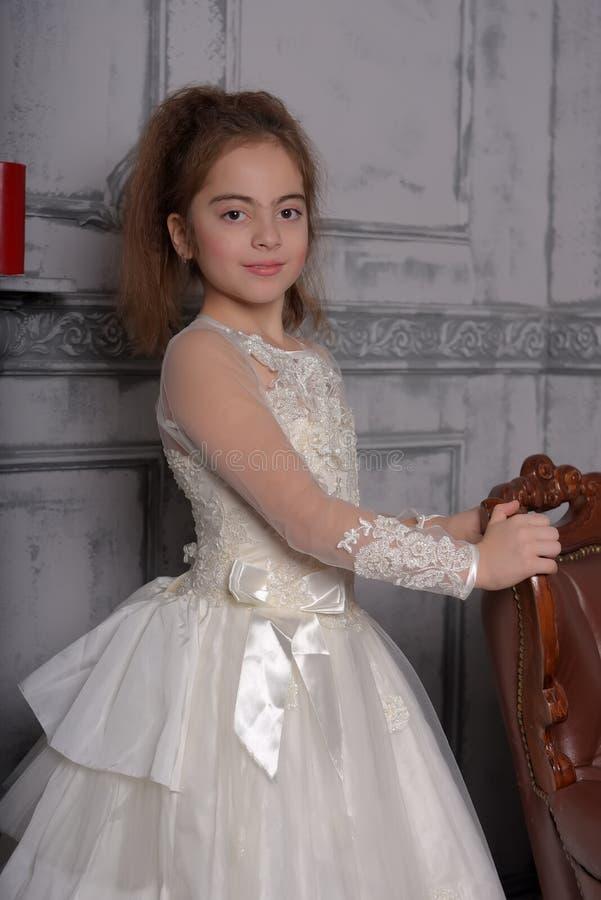 Stående av lilla flickan i lyxig klänning royaltyfria foton