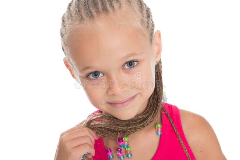 Stående av lilla flickan med dreadlocks royaltyfri bild