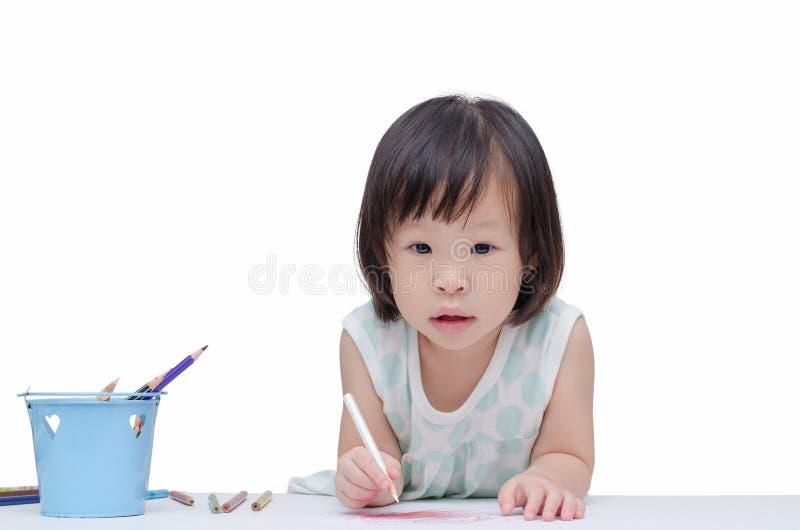 Stående av lite flickan som drar en skissa fotografering för bildbyråer