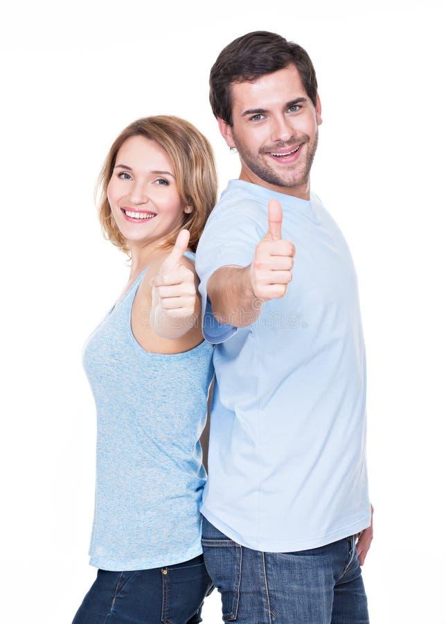 Stående av lyckliga par med tummar upp. royaltyfri fotografi