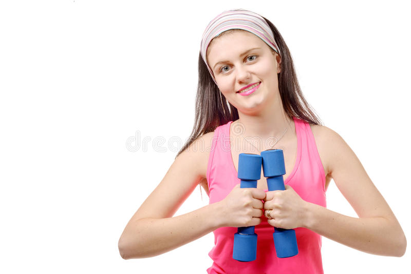 Stående av nätta sportiga flickainnehavvikter som isoleras på vit royaltyfri foto