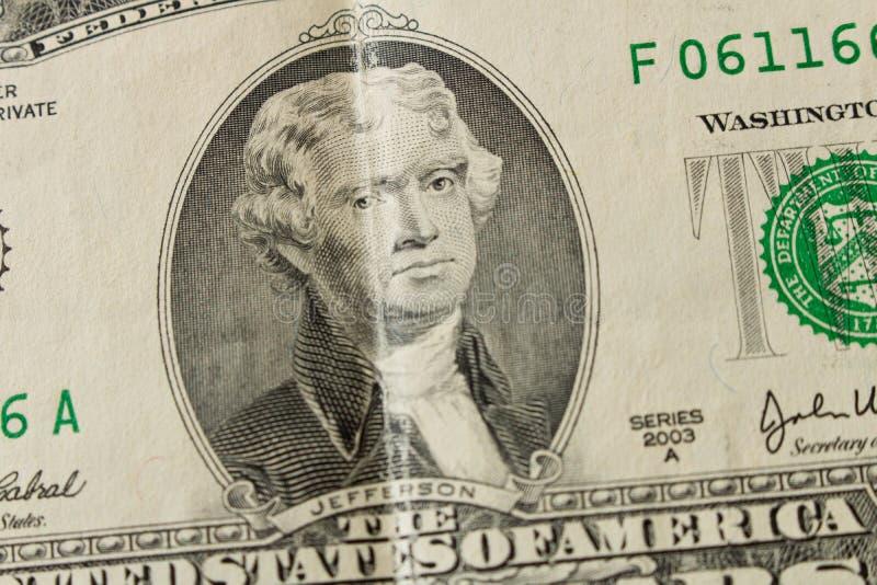 Stående av presidenten Thomas Jefferson på en räkning för dollar 2 clos arkivbild