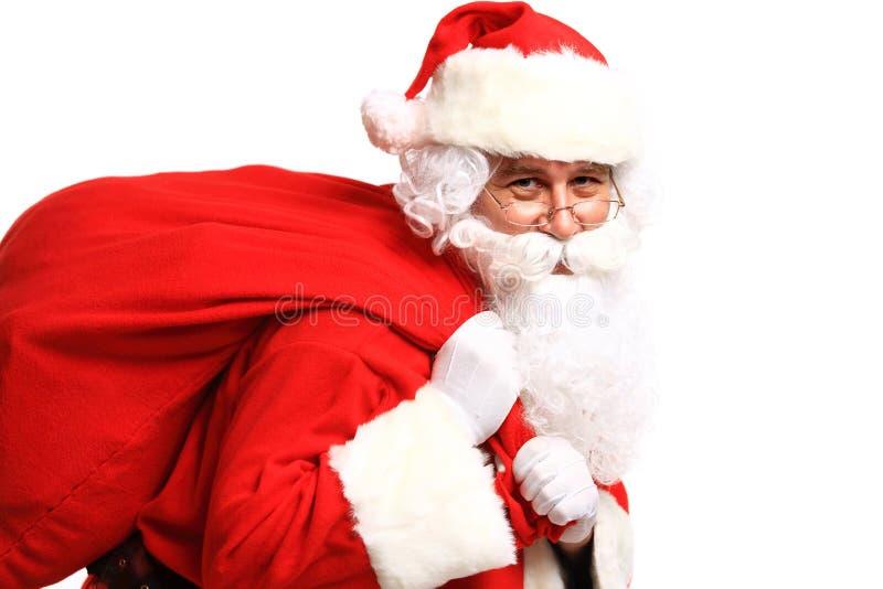 Stående av Santa Claus med den enorma säcken royaltyfri bild