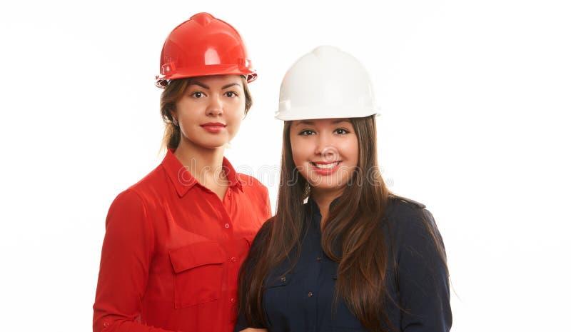 Stående av två kvinnliga teknikerer arkivfoton