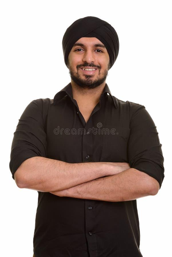 Stående av ungt lyckligt indiskt sikh- le för man royaltyfri foto