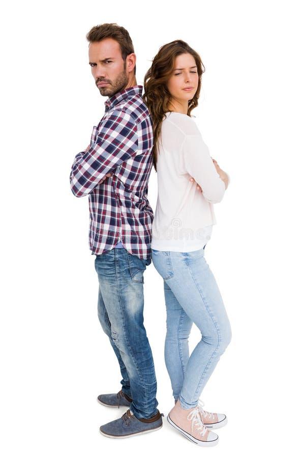 Stående deprimerade par tillbaka att dra tillbaka royaltyfri fotografi