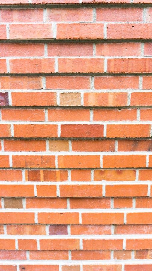 Stående funktionsläge för röd murverkvägg arkivfoton