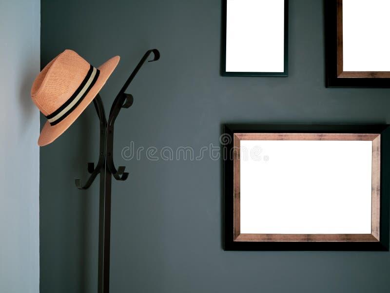 Stående hatthängare arkivbild