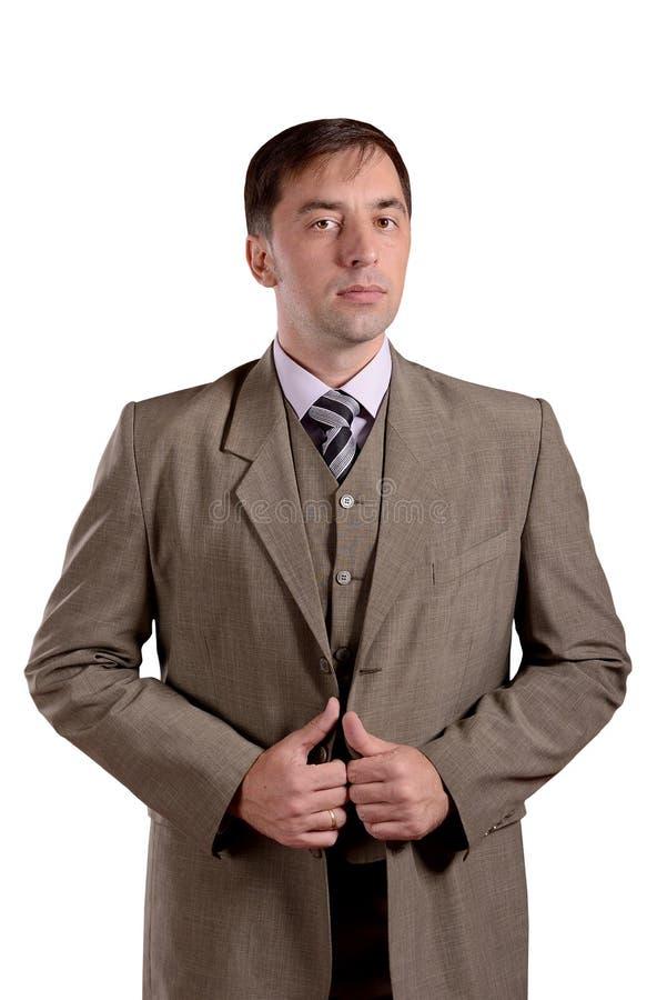 Stående stående för affärsman i dräkten för gammal stil som isoleras på whi royaltyfri fotografi