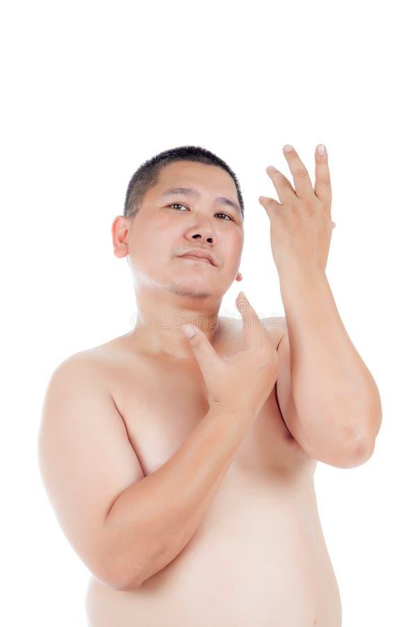 Ståenden av den knubbiga kala asiatiska mannen poserar som som ett härligt royaltyfria bilder