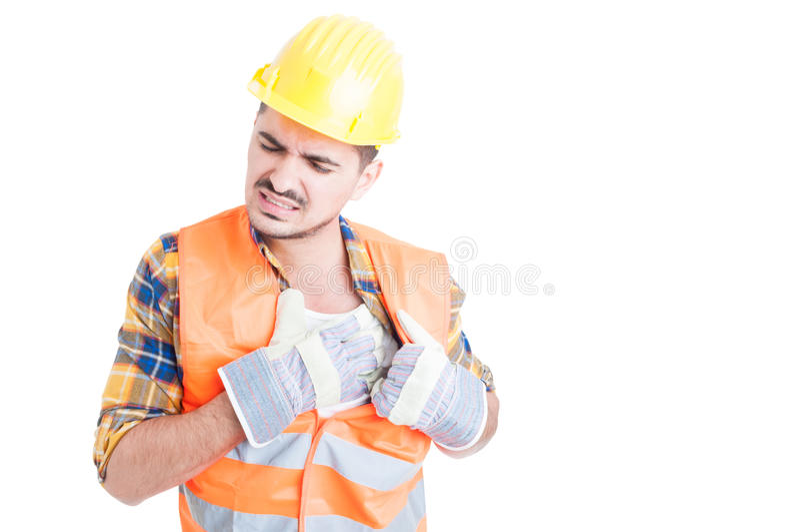 Ståenden av den unga konstruktörn som rymmer hans bröstkorg smärtar in royaltyfria foton