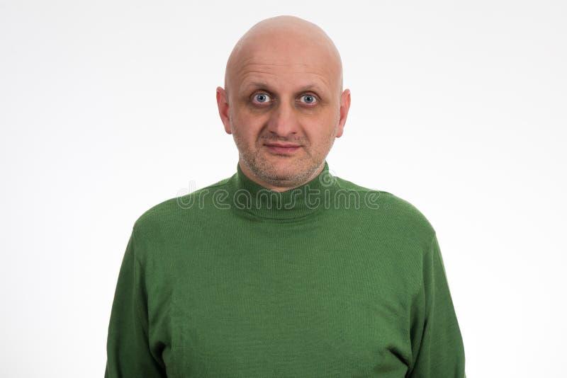 Ståenden av eftertänksamt barn blir skallig mannen royaltyfria foton
