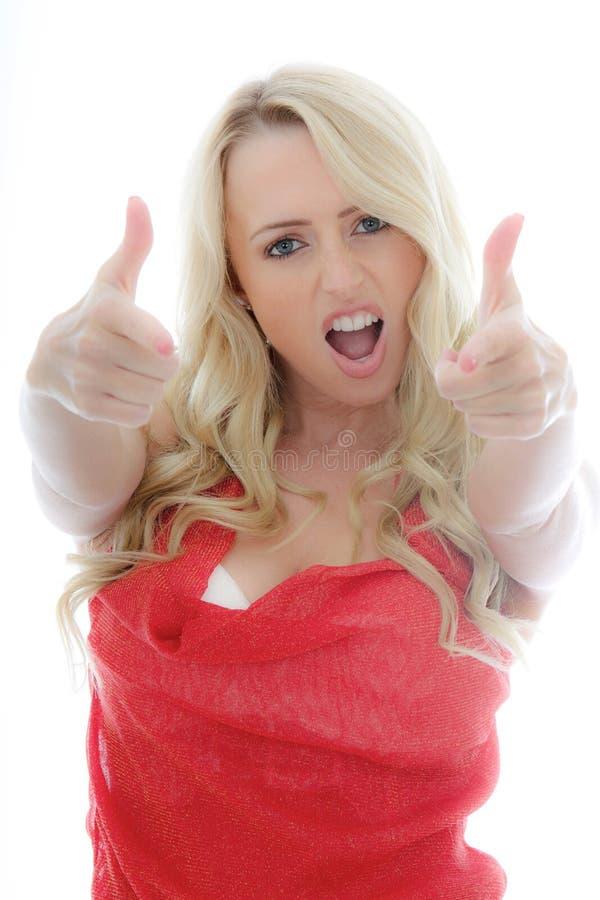 Ståenden av en flicka som firar med tummar, Up handgest royaltyfria bilder