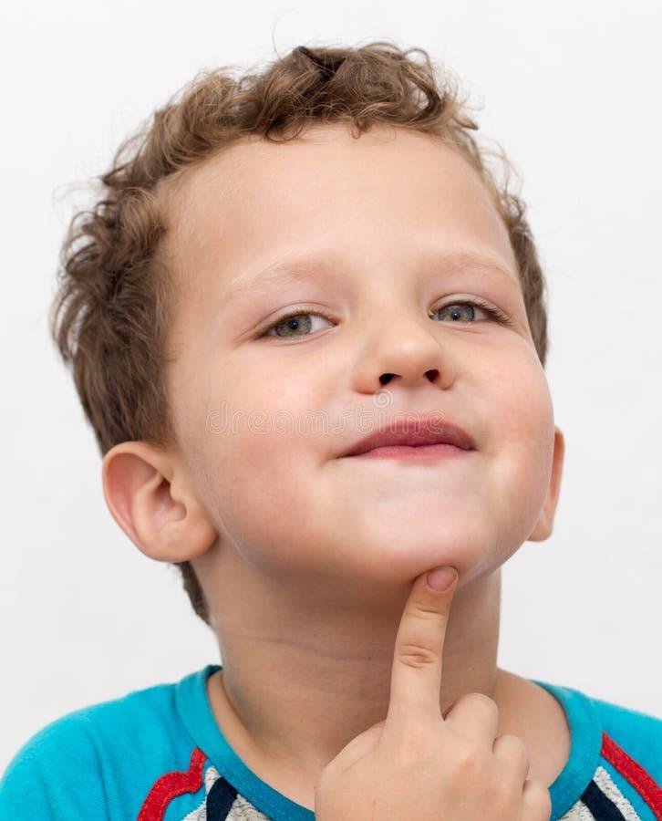 Ståenden av en framsida för pojke` s förvrider royaltyfri bild